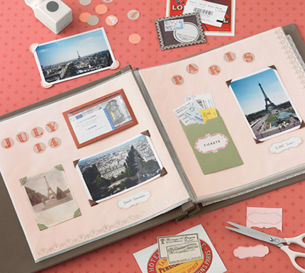 Open scrapbook with pink pages on table