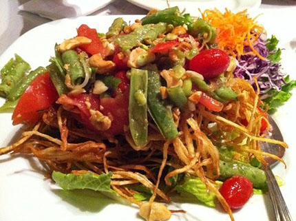 Celebrating small businesses by eating a plate of Thai fried papaya salad from a small, locally-owned restaurant in San Francisco.